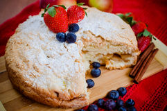 Apple pie and fruits. Apple pie with strawberries and blueberries Royalty Free Stock Photography