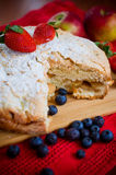 Apple pie and fruits. Apple pie and strawberries, blueberries and apples Royalty Free Stock Photo