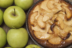 Apple pie. Green apples next to Stock Images