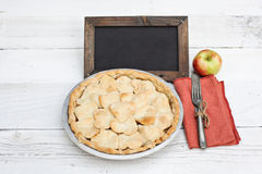 Apple pie with heart shaped crust topping with chalkboard Stock Images