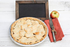 Apple pie with heart shaped crust topping with chalkboard Royalty Free Stock Photography