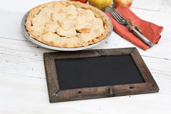Apple pie with heart shaped crust topping with chalkboard Royalty Free Stock Images