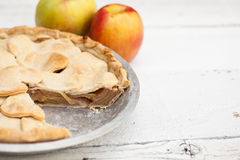 Apple pie with heart shaped crust topping Stock Photography