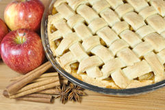 Apple pie. Homemade apple pie surrounded by red apples royalty free stock images
