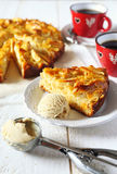 Apple pie, ice cream and cups of coffee Stock Image