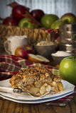 Apple pie with ingredients. Slice of deicious apple pie royalty free stock photos