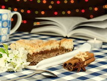 Apple pie and interesting book Stock Photography