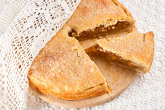 The apple pie with a lacy napkin Royalty Free Stock Images