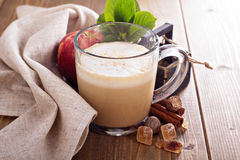 Apple pie latte with cinnamon and syrup Royalty Free Stock Image