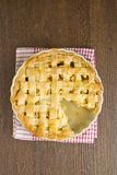 Apple pie with lattice top with slice taken Stock Image