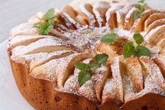 Apple pie with mint, cinnamon sprinkled with powdered sugar Stock Photo
