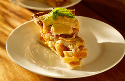 Apple pie with mint garnish. Royalty Free Stock Images