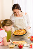Apple pie mother and daughter baking Royalty Free Stock Photo