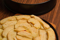 Apple pie near baking tray on table. And cook board Royalty Free Stock Photos