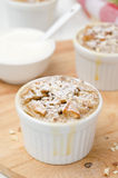 Apple pie with nuts in a white ramekin closeup Royalty Free Stock Image