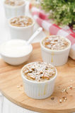 Apple pie with nuts in a white ramekin Stock Images