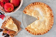 Apple pie, overhead scene with cut slice on marble background Royalty Free Stock Photos