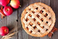 Apple pie overhead scene on rustic wood. Apple pie, overhead table scene on a rustic wooden background Stock Photo