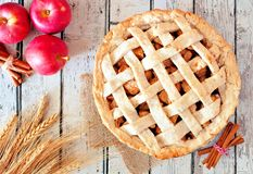 Apple pie overhead scene on white rustic wood. Homemade apple pie, overhead table scene on a rustic white wood background Stock Images