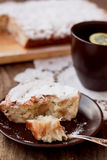 Apple pie. A piece of apple pie and a cup of tea Royalty Free Stock Photography
