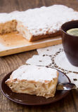 Apple pie. A piece of apple pie and a cup of tea Stock Photography