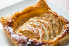 Apple pie. A piece of delicious square apple pie on white plate Royalty Free Stock Photography