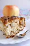 Apple-pie piece on a white table royalty free stock photo
