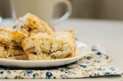 Apple pie on the plate. On the white table Royalty Free Stock Photography