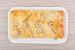 Apple pie in polyfoam tray on table Royalty Free Stock Images