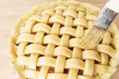 Apple pie in preparation with tip of brush Stock Photo