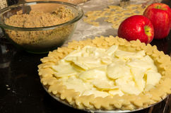 Apple pie ready for the oven with apples Stock Images