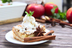 Apple pie, red apples, mint and spices Royalty Free Stock Image