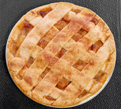 Apple pie. Served on a black place mat Royalty Free Stock Images