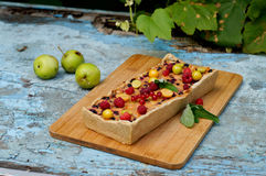 Apple pie served with red currants and raspberry Stock Image