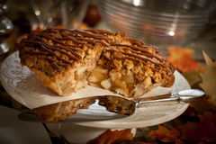 Apple pie on a serving plate. Slice of deicious apple pie stock photography