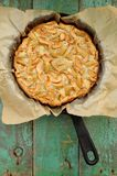Apple pie in skillet with baking paper Stock Photo
