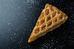 Apple pie slice on black table with sugar. Fresh apple pie slice on black table with sugar Stock Images