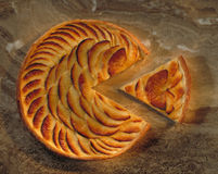 Apple pie with slice cut out Stock Photo