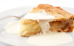 Apple Pie. A slice of apple pie on a plate with cream on top Stock Photos