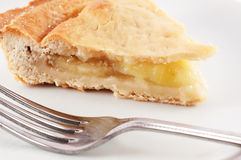 Apple pie. A slice of apple pie on a plate with a fork in the foreground Royalty Free Stock Image