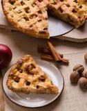 Apple pie slice on rustic setting. Fresh baked apple pie slice on rustic table setting Stock Images