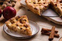 Apple pie slice on rustic setting. Fresh baked apple pie slice on rustic table setting Royalty Free Stock Image