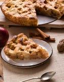 Apple pie slice on rustic setting. Fresh baked apple pie slice on rustic table setting Royalty Free Stock Photo