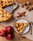 Apple pie slice on rustic setting. Fresh baked apple pie slice on rustic table setting Stock Image