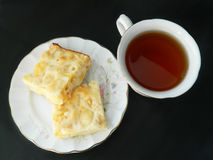Apple pie slices with cup of tea stock images