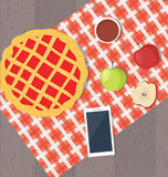 Apple pie and smart phone Stock Photography