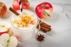 Apple pie smoothie. Healthy vegan food. Dietary breakfast or snack. Apple pie smoothies, with apples, yogurt, cinnamon, spices, walnuts. In a glass, on a white Royalty Free Stock Image