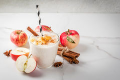 Apple pie smoothie. Healthy vegan food. Dietary breakfast or snack. Apple pie smoothies, with apples, yogurt, cinnamon, spices, walnuts. In a glass, on a white stock photos