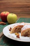 Apple pie strudel on white plate with gold ornament Stock Image