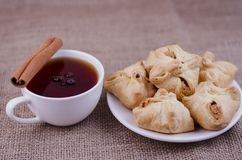 Apple pie and tea with anise and cinnamon stock photo